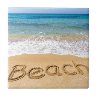Word Beach written in sand at greek sea Ceramic Tile