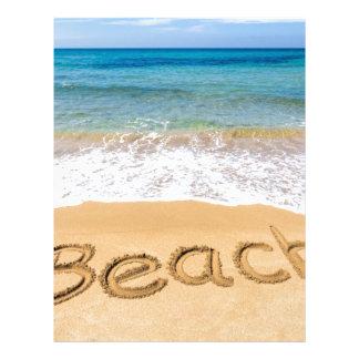 Word Beach written in sand at greek sea Letterhead