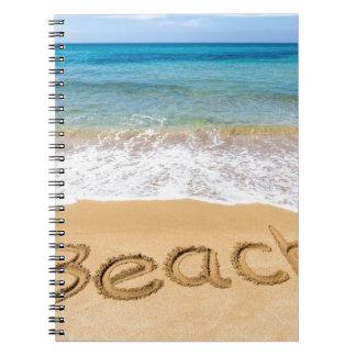 Word Beach written in sand at greek sea Notebook