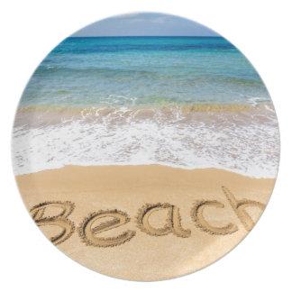 Word Beach written in sand at greek sea Plate