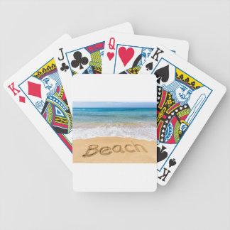 Word Beach written in sand at greek sea Poker Deck