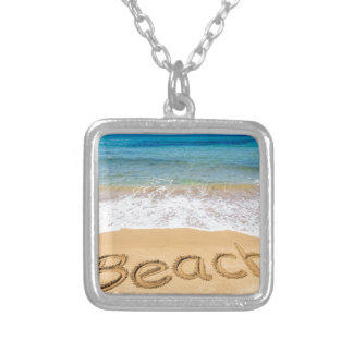 Word Beach written in sand at greek sea Silver Plated Necklace