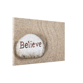 word Believe on beach rock Canvas Print