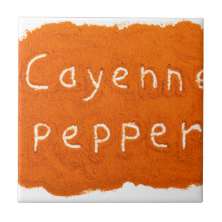 Word Cayenne pepper written in powder Tile
