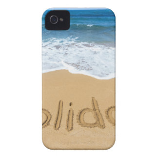 Word holiday written in sand on beach iPhone 4 cases