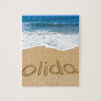 Word holiday written in sand on beach jigsaw puzzle