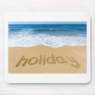 Word holiday written in sand on beach mouse pad
