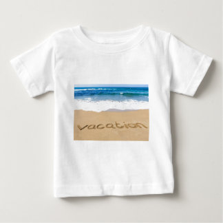 word vacation written on sand beach at sea baby T-Shirt