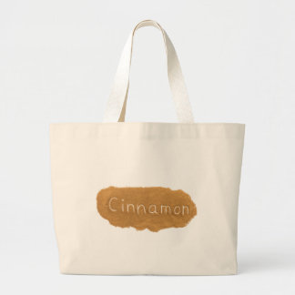 Word written in Cinnamon powder on white backgroun Large Tote Bag