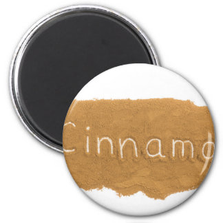 Word written in Cinnamon powder on white backgroun Magnet