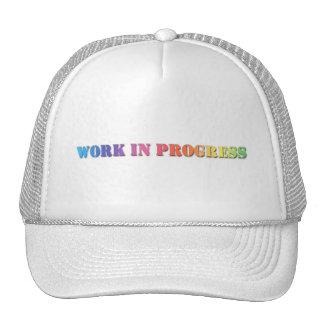 WORK IN PROGRESS Rainbow Stencil Text Trucker Hats
