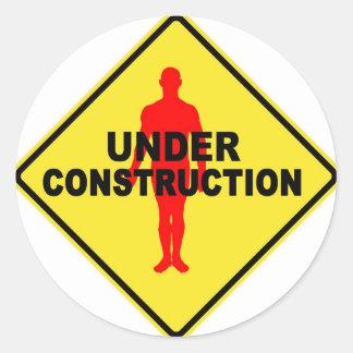 Work in progress symbol round sticker