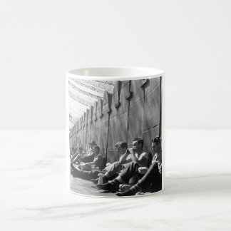 Workers eat lunch against FBY wing_War image Coffee Mug