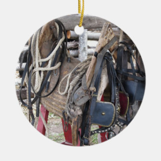 Worn leather horse bridles and bits ceramic ornament