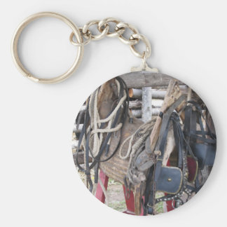 Worn leather horse bridles and bits keychain