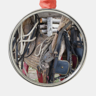 Worn leather horse bridles and bits metal ornament