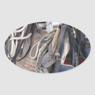 Worn leather horse bridles and bits oval sticker