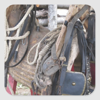 Worn leather horse bridles and bits square sticker