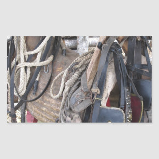 Worn leather horse bridles and bits sticker
