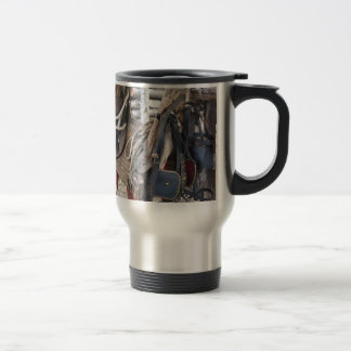 Worn leather horse bridles and bits travel mug
