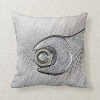 Wrench, bolt and nut on metal surface throw pillow