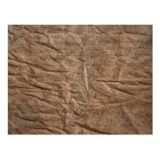Wrinkled brown paper handwriting postcard