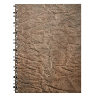 Wrinkled brown paper with handwriting notebook