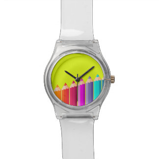 Wrist watch with color pencils.