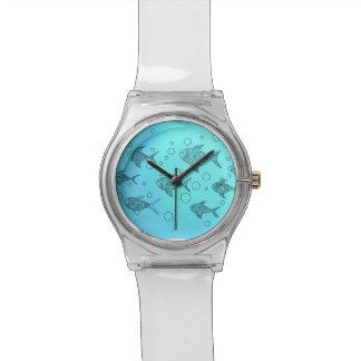 Wrist watch with swimming fish.