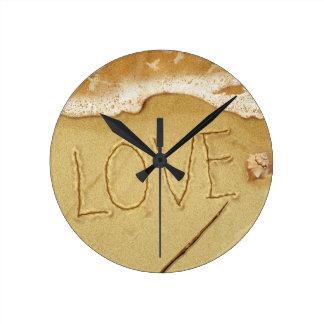Writing Love In The Sand Wallclock