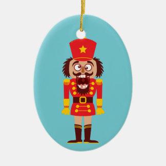 Xmas nutcracker breaks its teeth and goes nuts ceramic ornament