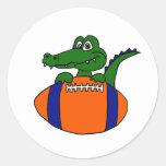 XX- Awesome Gator on a Football Cartoon Round Sticker