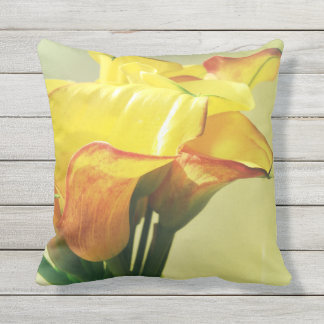 Yellow and orange calla lilies outdoor pillow