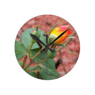 yellow and orange rose bud round clock