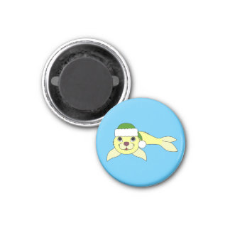 Yellow Baby Seal with Christmas Green Santa Hat 1 Inch Round Magnet