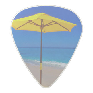 Yellow beach umbrella and chairs on pristine acetal guitar pick