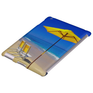 Yellow beach umbrella and chairs on pristine