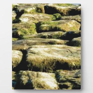 yellow blocks of rock plaque