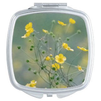 Yellow buttercups flowers compact mirror