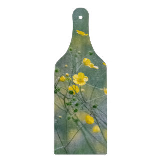 Yellow buttercups flowers cutting board
