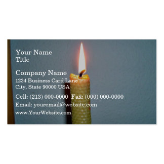 Yellow Candle flame against white wall Business Cards