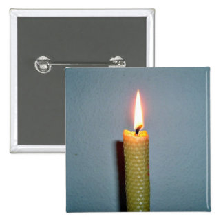 Yellow Candle flame against white wall Pin