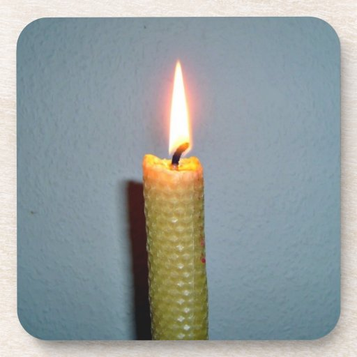 Yellow Candle flame against white wall Coaster