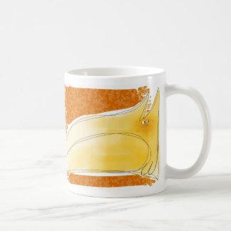 Yellow cat on cushion coffee mugs