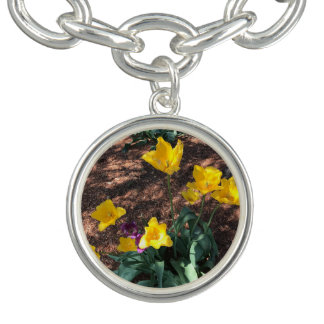 yellow colored tulip type flowers in spring charm bracelets