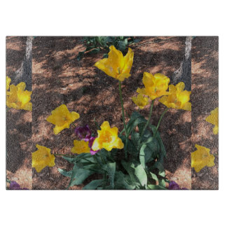yellow colored tulip type flowers in spring cutting board