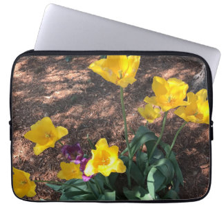 yellow colored tulip type flowers in spring laptop sleeve
