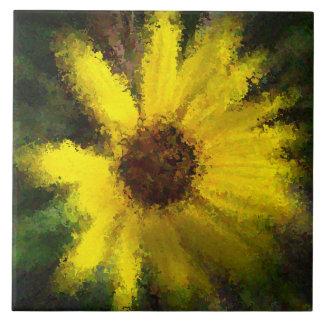 Yellow daisy on tile