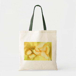 Yellow dancing rose petals tote bag
