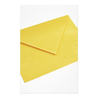 Yellow envelope isolated on white stationery